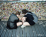 The Pont des Arts bridge is home to thousands of locks that have damaged the structure in Paris, France. The bridge will be renovated despite it's romantic tourist attraction. The bridge also employees immigrant vendors who sells locks and engravings daily.