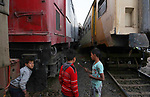Egytians children stand next to the scene of a train collision near Kom Hamadah, in the Beheira province in the Nile delta, Egypt on February 28, 2018. The death toll of the train crash that took place in Beheira province northern the capital Cairo on Wednesday has risen to 15, official MENA news agency reported. Beheira security chief Alaa El-Din Abdel-Fattah explained earlier on Wednesday that the accident took place as two cabins derailed from a passenger train and hit a cargo train in Kom Hamada district of Beheira. Photo by Amr Sayed