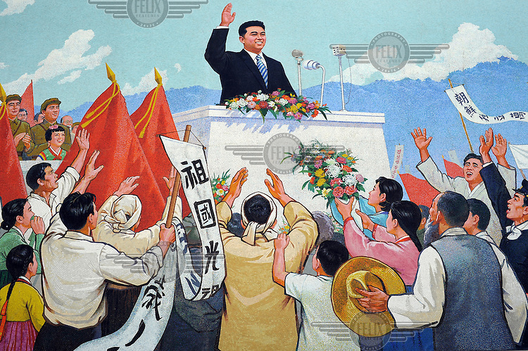 A propaganda poster, featuring Kim Il-sung, on a wall in the city centre......