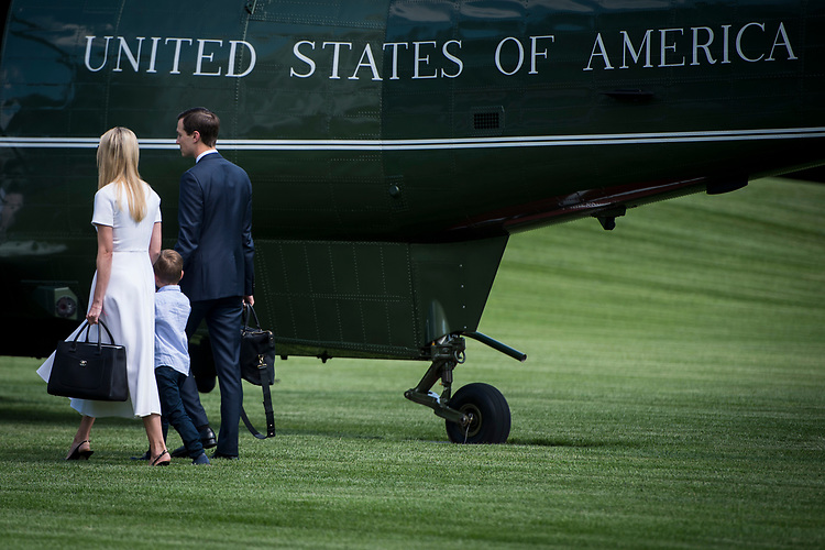 UNITED STATES – June 29: Ivanka Trump, her son Theodore Kushner and her husband Jared Kushner board Marine One shortly after leaving the White House Friday June 29, 2018.  (Photo By Sarah Silbiger/CQ Roll Call)