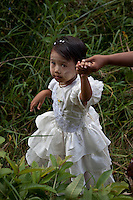 Young girl in her finest dress at the annual Boat Races at Phaung Daw Oo Pagoda on Inle Lake,Burma
