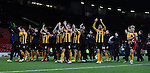 Cambridge players and staff salute their travelling fans - FA Cup Fourth Round replay - Manchester Utd  vs Cambridge Utd - Old Trafford Stadium  - Manchester - England - 03rd February 2015 - Picture Simon Bellis/Sportimage