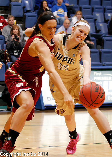 SIOUX FALLS, SD - MARCH 10:  Quincey Noonan #4 from Denver battles for the loose ball with Nicole Rogers #10 from IUPUI in the second half of their semifinal game at the 2014 Summit League Basketball Championships Monday at the Sioux Falls Arena(Photo by Dave Eggen/Inertia)