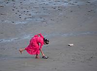Muslim Girl on the floodplains at a river bank, Rakhine State, Myanmar