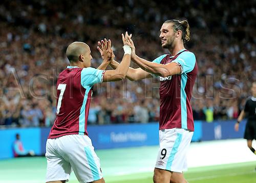 04.08.2016. Olympic Stadium, London, England. Europa League Football Qualifying 2nd Leg. West Ham versus NK Domzale. West Ham United's Sofiane Feghouli makes it 3-0 and celebrates with West Ham United Striker Andy Carroll