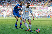 Angel Rangel of Swansea City (R) followed by Peter Crouch of Stoke City during the Premier League match between Swansea City and Stoke City at The Liberty Stadium, Swansea, Wales, UK. Sunday 13 May 2018