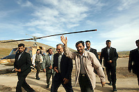 Iranian President Mahmoud Ahmadinejad waves at supporters, as he emerges from his helicopter, who have arrived at the airport in Ardabil to greet him during a provincial visit.