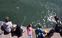 25/05/15<br /> <br /> A giant jelly-fish floats past as children lie on the quay, crabbing in Appledore, North Devon on bank holiday Monday.<br /> <br /> All Rights Reserved - F Stop Press.  www.fstoppress.com. Tel: +44 (0)1335 418629 +44(0)7765 242650