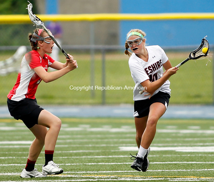 Stratford, CT-09 June 2012-060912CM02- Cheshire's Alison Hoynes (right) carries the ball as Greenich's Claire Feeney defends during the girls lacrosse Class L finals Saturday morning at Bunnell High School in Stratford.  Greenwich won the Class L title, after upsetting number one ranked Cheshire, 9-8.   Christopher Massa Republican-American