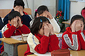 Shanghai, China. Peijia International School. Private school Kindergarten - High School. Many Students live here throughout the week. Grade 4. Students doing Chinese eye exercises, a daily routine followed in most Chinese schools. It is believed that these exercises, which have been practiced in China for centuries, reduce eye strain and improve vision. Students press their fingers on acupuncture points; this is known as acupressure. ©Ellen B. Senisi