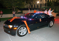Athletics car parade through the quad and non-fire<br /> Photo from Occidental College Homecoming & Family Weekend, Saturday, Oct. 26, 2012.<br /> (Photo by Marc Campos, Occidental College Photographer)