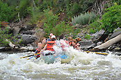 Colorado River Guides crashing Cable Rapid while floating the Upper Colorado River from Rancho Del Rio to Two Bridges on the afternoon of July 9, 2014.