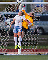 Boston Breakers goalkeeper Ashley Phillips (24) and Chicago Red Stars forward Ella Masar (3) leap for a shot at goal.  In a National Women's Soccer League Elite (NWSL) match, the Boston Breakers defeated  Chicago Red Stars 4-1, at the Dilboy Stadium on May 4, 2013.