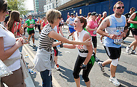 17 APR 2011 - LONDON, GBR - Sonja Lee Carey stops to talk with a friend during the London Marathon (PHOTO (C) NIGEL FARROW)