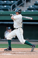 Center fielder Anthony Cheky (15) of the Michigan State Spartans bats in a game against the Harvard Crimson on Saturday, March 15, 2014, at Fluor Field at the West End in Greenville, South Carolina. Michigan State won, 4-0. (Tom Priddy/Four Seam Images)