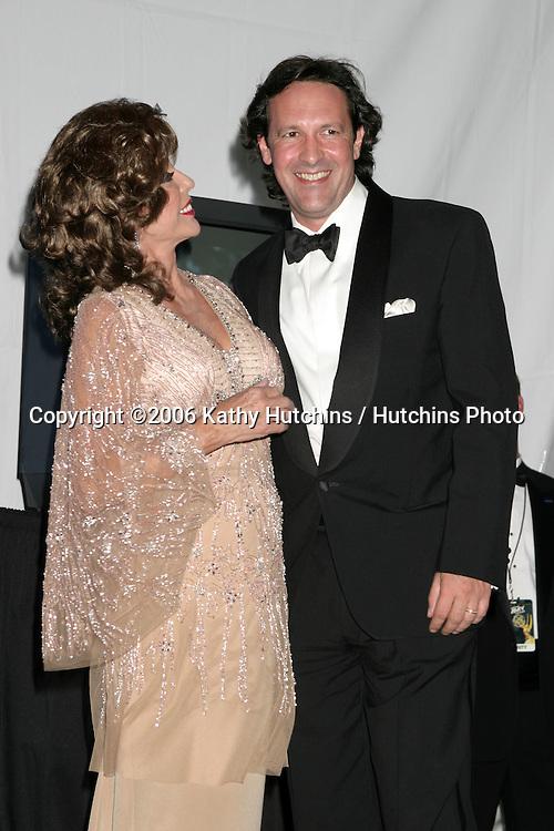Joan Collins & husband.58th Primetime Emmy Awards.Shrine Auditorium.Los Angeles, CA.August 27, 2006.©2006 Kathy Hutchins / Hutchins Photo....                 i