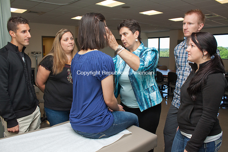 NORTH HAVEN, CT- MAY 31  2011-053112DA15-  Clinical Associate Professor and Director of the Physician Assistant Program at Quinnipiac University, Cynthia Lord, instructs students during class on Thursday. Lord has been honored by The American Academy of Physician Assistants with the 2012 Outstanding PA of the Year Award for her passionate support of PAs and their patients..Darlene Douty Republican American