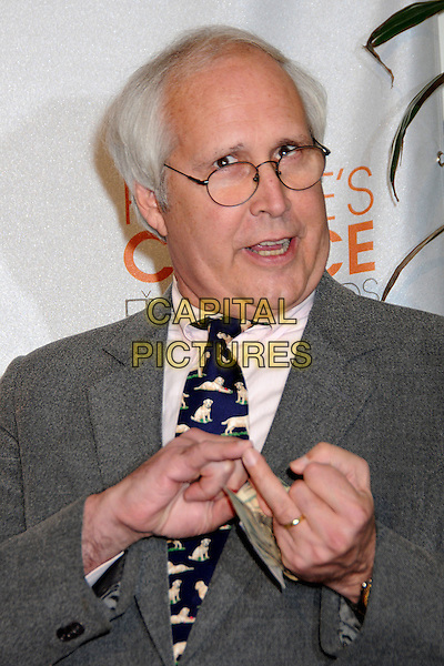 CHEVY CHASE.Pressroom at the 36th Annual People's Choice Awards held at the Nokia Theatre LA Live, Los Angeles, California, USA..January 6th, 2009.press room half length grey gray suit jacket pink shirt dog print tie black glasses hands finger ring mouth open.CAP/ADM/BP.©Byron Purvis/AdMedia/Capital Pictures.
