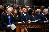From left, President Donald Trump, first lady Melania Trump, former President Barack Obama, Michelle Obama, and former President Bill Clinton listen during a State Funeral at the National Cathedral, Wednesday, Dec. 5, 2018, in Washington, for former President George H.W. Bush. <br /> Credit: Alex Brandon / Pool via CNP