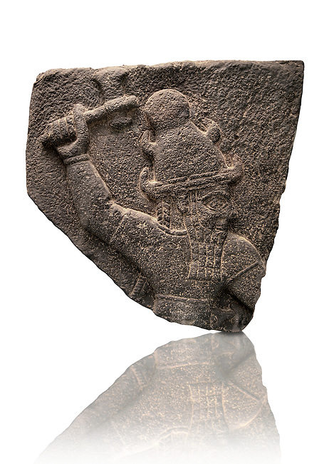 Neo Hittite Basalt relief sculpture for Carchemish of a Syrian storm god who traditionally wears a horned headdress. 10th century B.C form Carchemish , south-east Anatolia, Turkey. British Museum exhibit no ME 117909 in room 54.