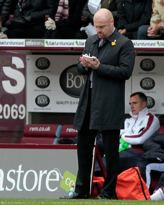 Burnley manager Sean Dyche  takes notes during the first half<br /> <br /> Photographer David Shipman/CameraSport<br /> <br /> Football - The Football League Sky Bet Championship - Burnley v Wolverhampton Wanderers - Saturday 19th March 2016 - Turf Moor - Burnley<br /> <br /> &copy; CameraSport - 43 Linden Ave. Countesthorpe. Leicester. England. LE8 5PG - Tel: +44 (0) 116 277 4147 - admin@camerasport.com - www.camerasport.com