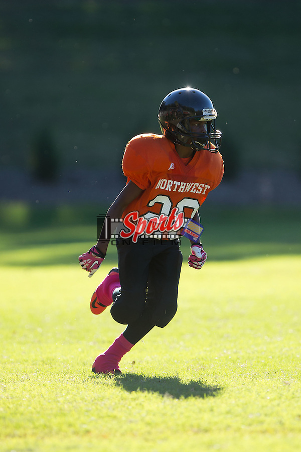 DeAvion Pless (28) of the Northwest Cabarrus Titans in action against the Winkler Wolves in 7th grade football action at Trojan Stadium October 7, 2014, in Concord, North Carolina.  The Titans defeated the Wolves 58-30.  (Brian Westerholt/Sports On Film)