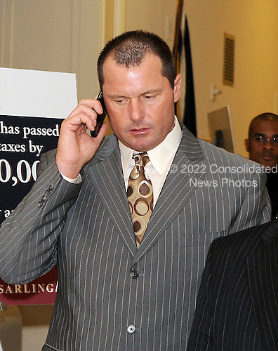 Washington, DC - February 12, 2008 -- Former New York Yankee pitcher Roger Clemens speaks on the phone after departing the office of United States Representative Dan Mica (Republican of Florida), the last office visit of the day, as he makes the rounds of the United States House of Representatives to meet members of the Government Operations and Reform Committee concerning his alleged use of human growth hormone (HGH) in Washington, D.C. on Tuesday, February 12, 2008.  He is scheduled to testify before the committee on Wednesday, February 13, 2008..Credit: Ron Sachs / CNP.(RESTRICTION: NO New York or New Jersey Newspapers or newspapers within a 75 mile radius of New York City)