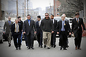 Seven New Orleans police officers with their attorneys and supporters arrive to turn themselves in at the city jail in New Orleans, Tuesday, Jan. 2, 2007. Each officer faces at least one charge of murder or attempted murder in the shootings of six people on the Danzinger Bridge in the aftermath of Hurricane Katrina..(AP Photo/Cheryl Gerber).