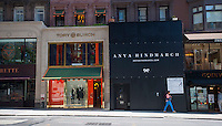 Tory Burch and soon to arrive Anya Hindmarch stores on Madison Avenue in New York on Saturday, September 15, 2012. In the last 18 months almost 50 luxury goods and designer stores have opened on Madison Avenue which was hit with numerous vacancies in the last few years. (© Richard B. Levine)