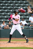Hickory Crawdads Left fielder Pedro Gonzalez (4) bats during the game with the Charleston Riverdogs at L.P. Frans Stadium on May 12, 2019 in Hickory, North Carolina.  The Riverdogs defeated the Crawdads 13-5. (Tracy Proffitt/Four Seam Images)