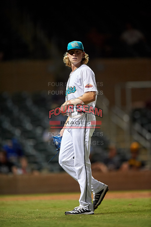 Salt River Rafters relief pitcher Shane Baz (35), of the Tampa Bay Rays organization, walks off the field between innings of an Arizona Fall League game against the Mesa Solar Sox on September 27, 2019 at Salt River Fields at Talking Stick in Scottsdale, Arizona. Salt River defeated Mesa 6-1. (Zachary Lucy/Four Seam Images)