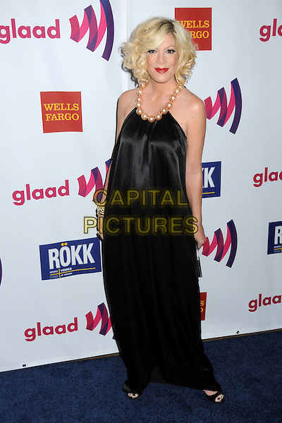 TORI SPELLING.22nd Annual GLAAD Media Awards held at the Westin Bonaventure Hotel, Los Angeles, California, USA,    .10 April 2011..full length black silk satin pearls beads dress long maxi  gold bracelet .CAP/ADM/BP.©Byron Purvis/AdMedia/Capital Pictures.