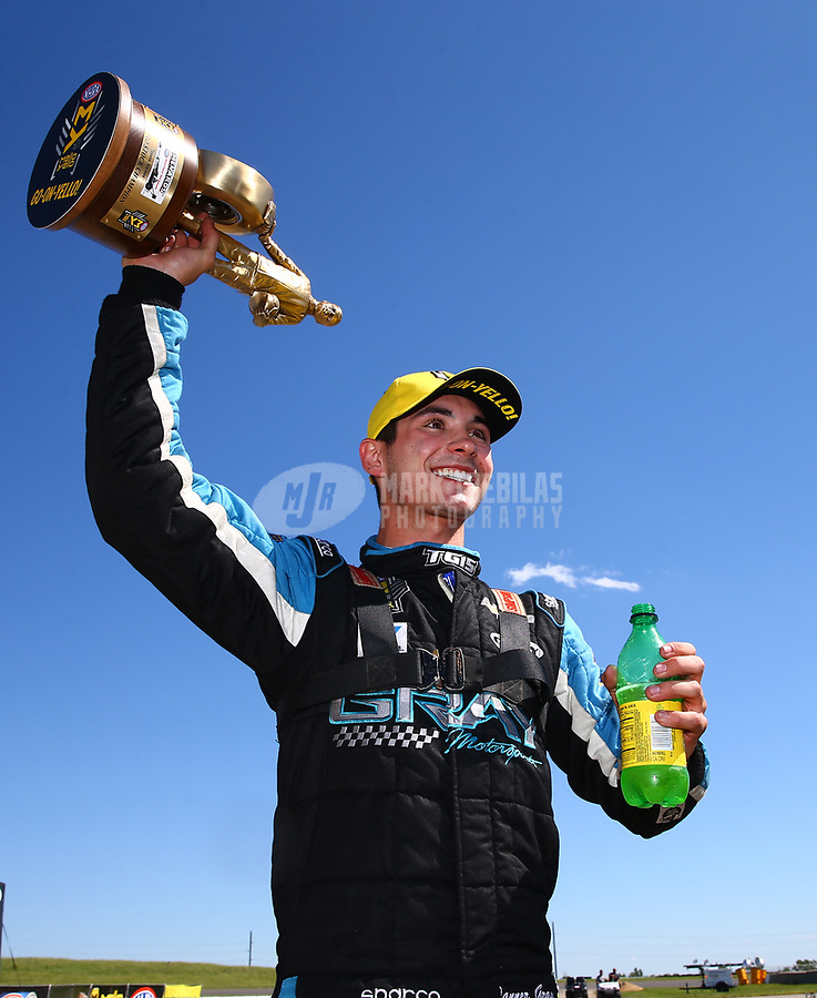 May 21, 2017; Topeka, KS, USA; NHRA pro stock driver Tanner Gray celebrates after winning the Heartland Nationals at Heartland Park Topeka. Mandatory Credit: Mark J. Rebilas-USA TODAY Sports