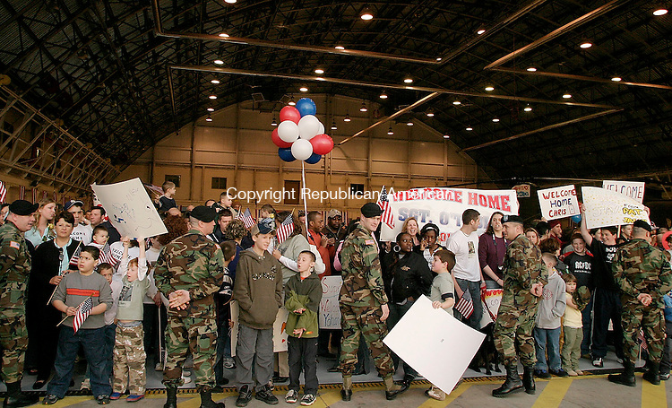 WINDSOR LOCKS, CT- 26 MARCH 2005-032605J07--Hundreds of friends and family members gathered to wolcome home soldiers from the C Company 102nd Infantry of Bristol as they return to the Army Avation Support Facility in Windsor Locks on Saturday. The soldiers are returning after serving in Iraq. --- Jim Shannon Photo--Army Avation Support Facility; Windsor Locks; are CQ