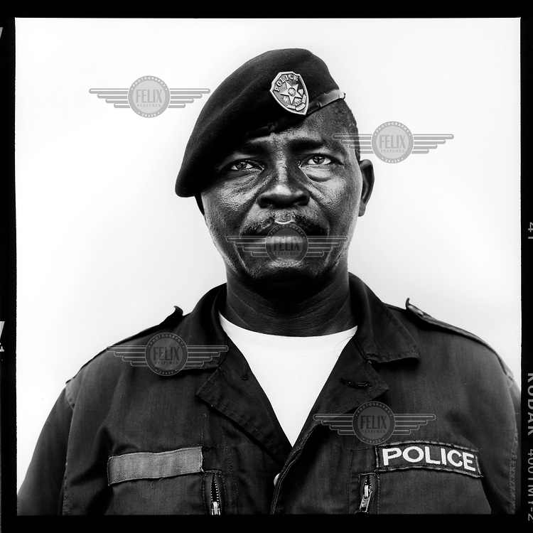 Lumbi Mbaja, policeman: 'No, I never wanted to be a soldier. What are you thinking of? Days spent training in the bush in the heat amongst vermin. Just give me the city, as a policemen. A policeman is in contact with the population. As long as we don't have to go on 'point duty'. I see no fun in controlling traffic on a busy crossroads. Having to stand in the middle of the heat and dust waving your arms between smelly buses and hooting cars.'.