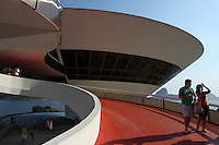 The Niteroi Contemporary Art Museum ( Museu de Arte Contemporanea de Niteroi — MAC ), situated in the city of Niteroi at the border of Guanabara bay, in front of Sugar Loaf mountain in Rio de Janeiro, Brazil, and is one of the city's main landmarks. Designed by architect Oscar Niemeyer with the assistance of structural engineer Bruno Contarin.