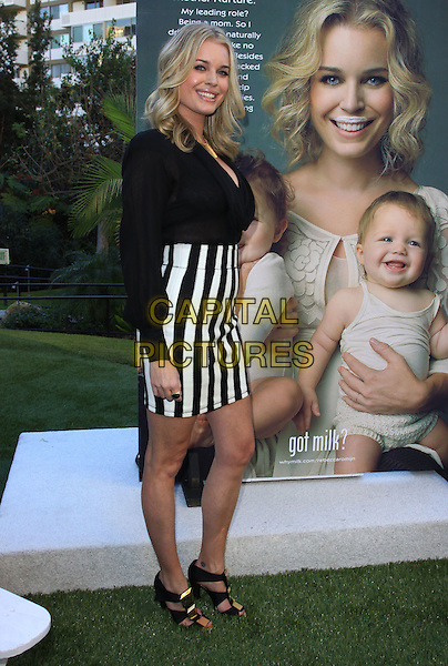 "REBECCA ROMIJN.Rebecca Romijn launches the National Milk Mustache ""got milk?"" held At The W Hotel, Westwood, California, USA..January 11th, 2009.full length black shirt white striped stripes skirt poster.CAP/ADM/KB.©Kevan Brooks/AdMedia/Capital Pictures."