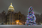 December 11, 2016; Main Building and Christmas tree during snowfall (Photo by Matt Cashore/University of Notre Dame)