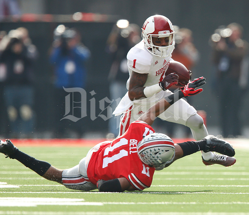 Indiana Hoosiers wide receiver Shane Wynn (1) runs over Ohio State Buckeyes defensive back Vonn Bell (11) in the 1st quarter at Ohio Stadium Nov. 22, 2014.(Dispatch photo by Eric Albrecht)
