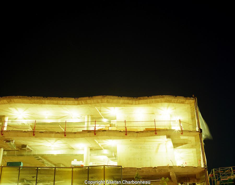 Building under construction illuminated at night