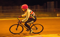 31 MAR 2015 - IPSWICH, GBR - Charlie-Jane Herbert takes a corner during an Ipswich Cycle Speedway Club training session at Whitton Sports and Community Centre in Ipswich, Great Britain (PHOTO COPYRIGHT © 2015 NIGEL FARROW, ALL RIGHTS RESERVED)