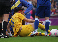 Women's Olympic Football match France v Sweden on 3.8.12...Lotta Schelin of Sweden getting treatment, during the Women's Olympic Football match between France v Sweden at Hampden Park, Glasgow..............