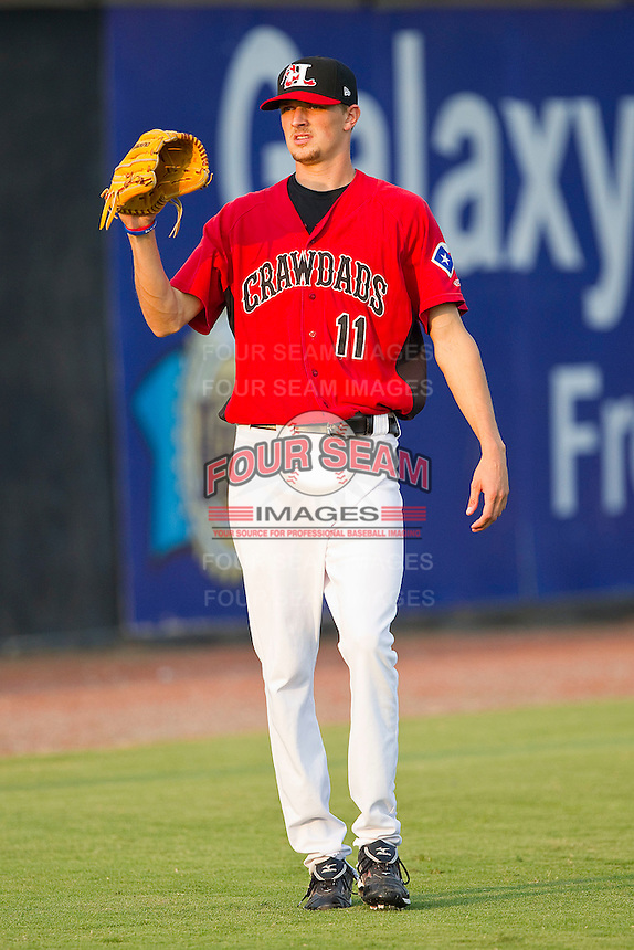 Starting pitcher Will Lamb #11 of the Hickory Crawdads warms up in the outfield prior to the game against the Greenville Drive at L.P. Frans Stadium on September 3, 2011 in Hickory, North Carolina.  The Crawdads defeated the Drive 3-0.  (Brian Westerholt / Four Seam Images)