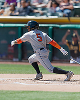 Tony Kemp (5) of the Fresno Grizzlies follows through on his swing against the Salt Lake Bees during the Pacific Coast League game at Smith's Ballpark on April 16, 2017 in Salt Lake City, Utah. Salt Lake defeated Fresno 5-4. (Stephen Smith/Four Seam Images)