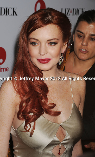 BEVERLY HILLS, CA - NOVEMBER 20: Lindsay Lohan arrives at the 'Liz & Dick' - Los Angeles Premiere at the Beverly Hills Hotel on November 20, 2012 in Beverly Hills, California.