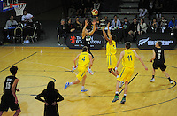 Action from the 2012 FIBA Oceania Men's U19 Championship match between NZ Junior Tall Blacks and Australian Emus at Te Rauparaha Arena, Porirua, Wellington, New Zealand on Saturday, 22 September 2012. Photo: Dave Lintott / lintottphoto.co.nz