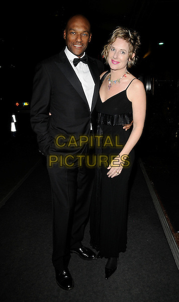 COLIN SALMON & FIONA HAWTHORNE .At the Hilton in the Community Foundation Ball, Hilton Park Lane,  London, England, UK, .October 18th 2008..full length black tuxedo bow tie suit dress married couple husband wife .CAP/CAN.©Can Nguyen/Capital Pictures