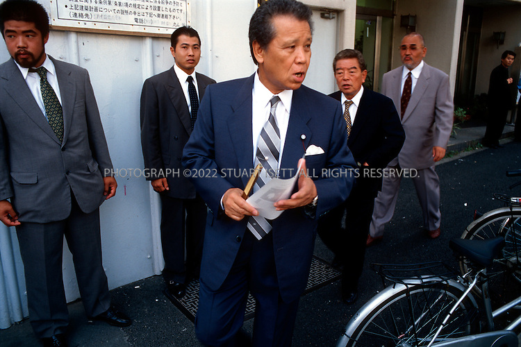 8/15/03--Tokyo, Japan..A Tokyo gang boss, Agata, meets a group of young members of a Japanese yakuza gang gathered on the streets in Tokyo's famous Kabukicho red light district...Photograph by Stuart Isett.©2004 Stuart Isett