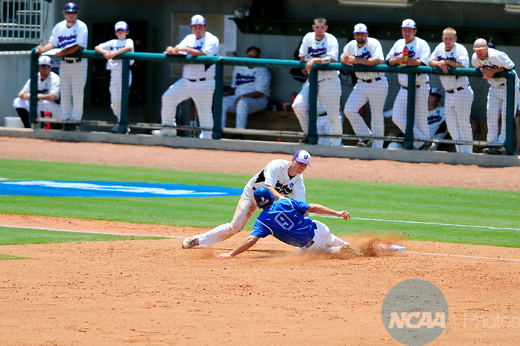04 JUNE 2011:  Korey Domenick (9) of the University of West Florida is tagged out at third base by Jared Anderson (9) of Winona State University during the Division II Men's Baseball Championship held at the USA Baseball National Training Complex in Cary, NC. West Florida defeated Winona State 12-2 to win the national title.  Grant Halverson/ NCAA Photos