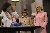 Rockefeller Chapel celebrated Mother's Day with service, African music sung by the Rockefeller Chapel Children's Choir and even a baptism.<br /> <br /> Noah Robert Tryon was baptized by Bromleigh McCleneghan as his grandmother Joyce Tryon and mother Jennifer Tryon stood by.